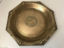 gold coloured metal plate with lion with sword                                AN
