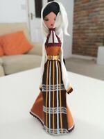 "9"" Wooden Folk Woman Figurine In Multi Fabric Costume - Marks on Costume"