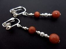 A PAIR OF BROWN GOLDSTONE  SILVER PLATED  CLIP ON EARRINGS. NEW.