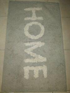 שטיח אפור לבן