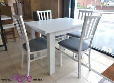 White extending dining table, strong and solid, great size, perfect for all room
