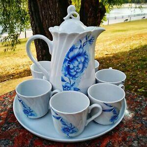Ceramic set. A jug, a 6-cups, a big plate. European porcelain