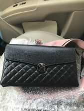 Glamour trends black purse!  Can carry as a clutch or use strap!! Real leather!!