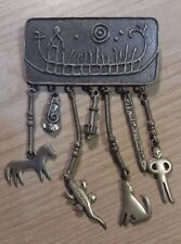 Vintage Jewelry Abstract pin with hanging figures