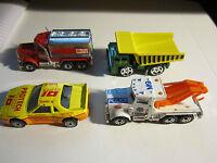 LOT OF 4 VINTAGE MATCHBOX: '81 PETERBILT, '89 DUMP TRUCK, '85 FIERO, '81 POLICE
