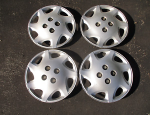 Genuine 2000 to 2002 Saturn S series bolt on 14 inch hubcaps wheel covers