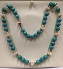 Halskette, Türkise, Perlen. Verschluss und Distanzstücke in 585er Gelbgold.
