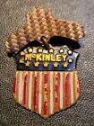 William McKinley c. 1896 red/white pinback brass & enamel dangling shield
