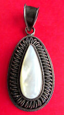 MOTHER OF PEARL TEAR DROP STONE IN SILVER OVAL PENDANT FILIGREE