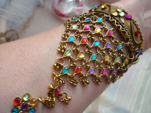 Meshed embossed gold-plated multi-coloured crystals 62 gram hinged ethnic bangle