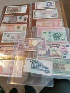 Forty eight foreign bank notes from around the world including folder bulk lot