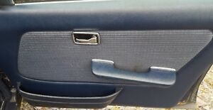 MERCEDES E280 W123 SALOON DRIVERS DOOR CARD WITH POCKET AND ARMREST BLUE