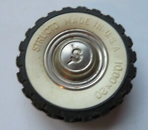 """Original white wall tire with an S in hub for Structo toy truck  2 3/8"""" diameter"""
