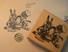"""Alice in Wonderland """"stuffing pig"""" WM Rubber stamp 2x2."""
