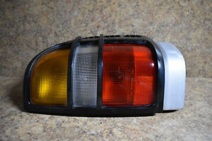 1998-1999 Isuzu Rodeo RIGHT REAR Passenger Side Tail Light w/ SILVER Body Panel