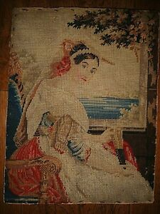 Antique needlework wool work embroidery of lady by window