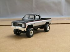 dcp/greenlight lifted 1982 GMC square body black/silver 4x4 1/64..