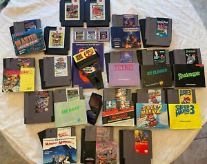 Lot of 19 NES Nintendo games, 3 Gameboy games and NES Game Genie