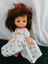 "vintage Perfekta 9"" doll with sleepy eyes wearing strawberry dress"