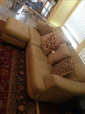 leather tan couch with ottemn and pillows