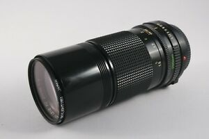Canon FD fit 200mm f/4 telephoto lens with Vivitar case, manual focus, filter