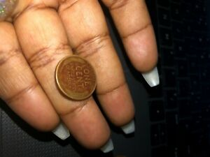 Real copper 1948 wheat penny with letter D under the year