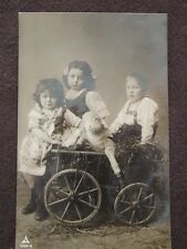 YOUNG CHILDREN IN MINI HAY WAGON WITH BABY LAMB - VTG REAL PHOTO POSTCARD