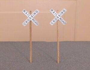 (2) RAILROAD CROSSINGS SIGNS