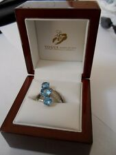 18K White Gold Ring with 3 Blue Topazes and 6 diamonds