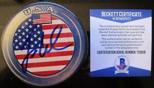 JACK EICHEL BUFFALO SABRES SIGNED USA HOCKEY PUCK BECKETT BAS COA T23218