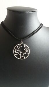 """TREE OF LIFE PENDANT ON  16"""" LOOPED  BLACK SUEDE CORD.  NEW BAGGED"""