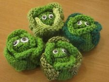 A HAND KNITTED BRUSSEL SPROUT TABLE DECORATION. FOR A FERRERO ROCHER CHOC.