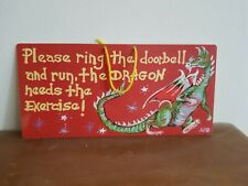Ring the doorbell/dragon sign