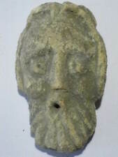 Frown (gargoyle) medieval stone, coming from an old window