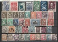 A selection of early Portugal postage stamps.