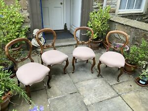 Four Victorian mahogany balloon back dining chairs
