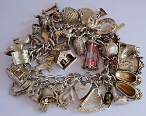 Wonderful vintage solid silver charm bracelet & 36 charms,rare,open.move.107.9g