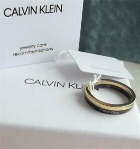 CALVIN KLEIN STAINLESS STEEL YELLOW GOLD PLATED BAND RING UK-P; BNWT BOX RRP £65
