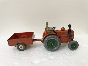 DINKY TOYS MASSEY HARRIS TRACTOR WITH DRIVER AND TRAILER