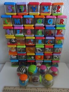Lot of 48 Fisher Price Peek A Boo Roll-A-Round Building/Stacking Sensory Blocks