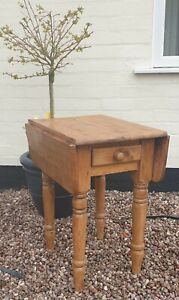 Antique pine table occassinal/ side table  Drop leaf central draw lovely patina
