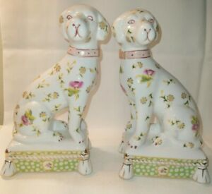 Pair of ceramic, flowered dog bookends