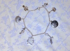 DAINTY Estate vtg BY THE SEA Ocean Nautical CHARM BRACELET 8 charms /shells boat