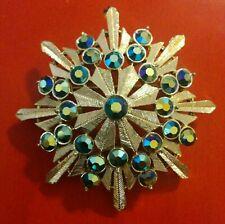 Vtg CORO AB Aurora Borealis Blue Rhinestone Starburst Brushed Gold Tone Brooch