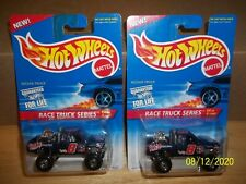 2 Hot Wheels 1996 Race Track Series Nissan Truck also known as Nissan Hardbody