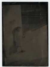 ANTIQUE TINTYPE CHILD HOLDING BALLOON, OUTDOOR ZOO SETTING.