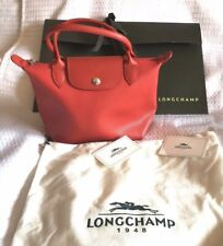 Longchamp Mini Le Pliage Cuir Leather Top Handle Bag in Red with silver met.395$