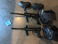 2 tippman 98 custom paintball guns, with 2 masks, and 2 hoppers