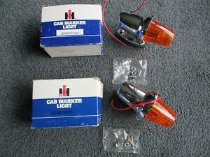 2 NOS IH INTERNATIONAL HARVESTER AMBER CAB MARKER LIGHTS 379619C91