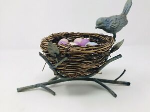 Decorative Metal Bird on a Branch with a Brown Wicker Nest Full of Eggs